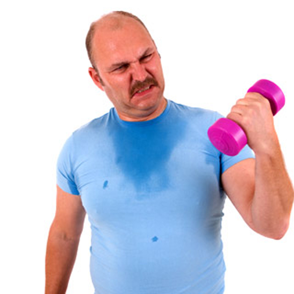 Mature male trying to lift one kilo weights with a lot of effort